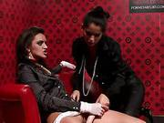 One Brunette Dominates Another With A Vibrator