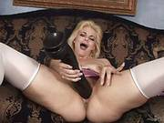 Blonde Beauty Alice Frost Is Sticking A Huge Dick Between Her Long Stockings Legs